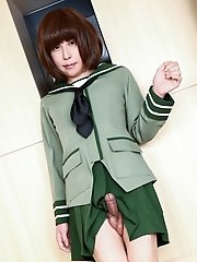 Japanese ladyboy Miharu Tatebayashi strips down her school uniform and plays with her cock.